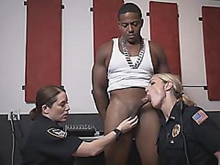 Busty Cops Get On Knees And Take Turns On Massive Black Dicks