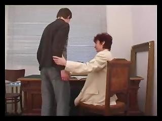 Russian Mature Headmistress With Young Boy
