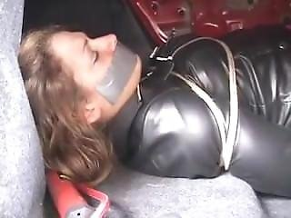 Woman In Leather And Boots Is Kidnapped And Tied Up