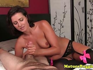 Mature In Lingerie Giving Tugjob To Lucky Dude