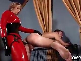 Goddess Brianna In Red Latex Fucks Her Male Slave Until He Shakes