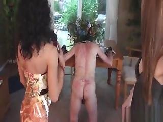 Two Dommes Whip Naked Male Slave