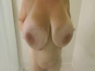 Huge Natural Boob Milf Rubbing Monster Tits On The Glass