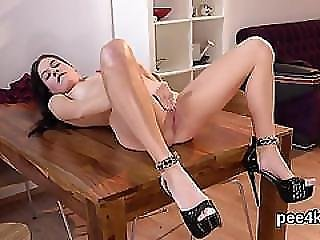 Ravishing Sweetie Is Pissing And Pleasuring Smooth Twat