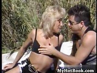 Leslie Glass Is A Hot Blonde  Who Is Found Tanning