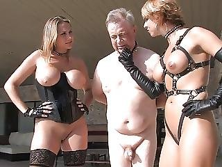 Two Mistresses Caning Older Man