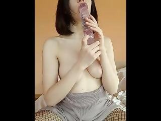 Teen In Fishnets Fucks Herself With Clear Dildo