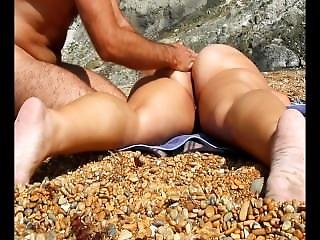 Giving Her An Erotic Massage At The Nudist Beach From Look4milf.com