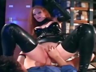 Pretty Redhead In A Latex Unifom And High Heels Fucking In A Warehouse