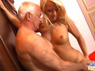 Young Blonde Taking Care Of A Grandpa