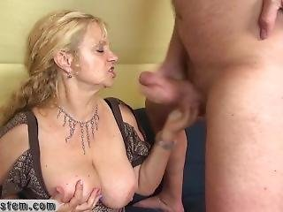 Elderly Blonde With Big Breasts Fiddles With Clitoris And Sucks A Dick
