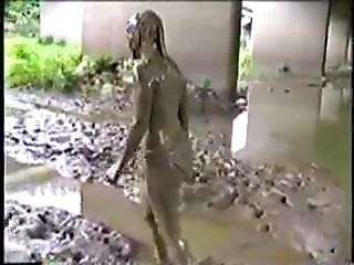 Cutie In Yellow Shirt Bathing In Mud