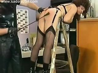 Milf Slave With Metal Clamps On Her Nipples Is Hit With A Whip