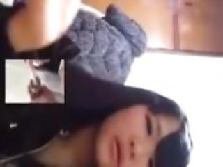 Teen asian girl smoking