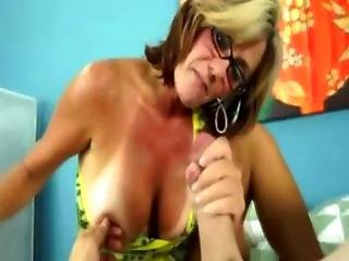 Big tit blond tugging and giving handjob to lucky pov guy