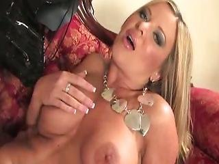 Blonde In Leather Corset Teases