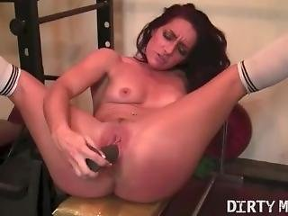 Naked Fit Brunette Fucks A Dildo In The Gym