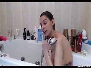 Skinny Brunette In Shower
