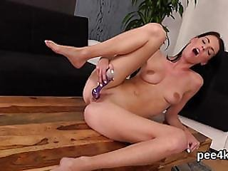 Gorgeous Nympho Is Peeing And Finger Fucking Shaven Kitty
