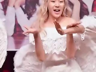 Asian Girl Dressed As An Angel Dances In Front Of A Crowd