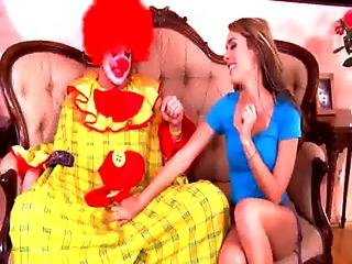 Horny Babe Goes Down On Clown On Couch