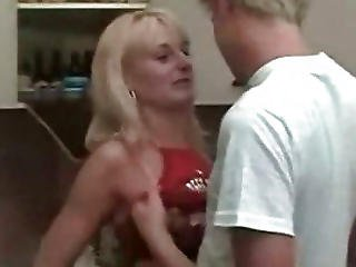 Blonde Mom And Son At Kitchen