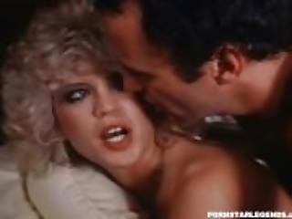 Amber Lynn double fucked on a bed