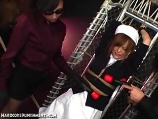 Japanese Submissive Nurse Is Tied To A Rack And Punished By A Femdom
