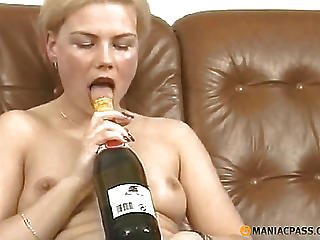 Bottle Of Champagne Caresses Her Bawdy Cleft