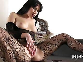 Attractive Kitten Is Urinating And Fingering Smooth Pussy
