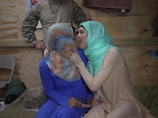Two Arab Babes Kissing While Soldiers Are Watching