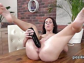 Attractive Chick Is Peeing And Masturbating Shaved Slit