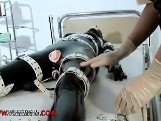 Latex Nurse Takes Care Of Rubberdoll Patient