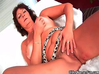 Busty Brunette Mature Rubs Her Hairy Cunt