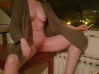 Horny Redhead Smoking And Jilling At An Open Window