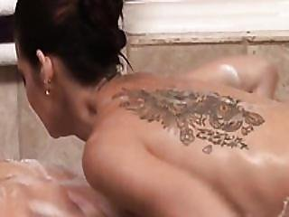 Busty Masseuse Sixtynines In Bathroom