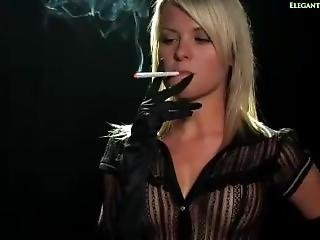 A Blonde Girl Smokes A Cigarette. Her Transparent Top Shows Her Sexy Tits!