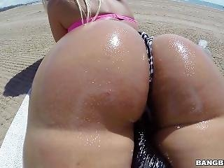This Blonde Moves Her Oiled Ass On The Beach