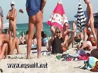 Naomi1 Handjob A Young Guy On A Public Beach