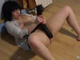 Masturbates Hairy Pussy With A Huge Dildo