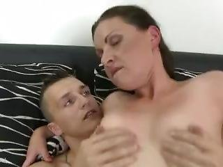 Shaved Brunette Mom Gets Nailed By A Young Dude