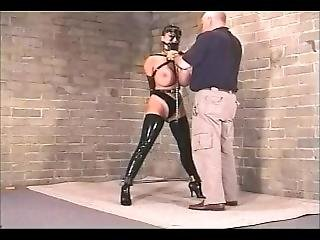 Giant-titted Brunette Fitted With Armbinder & Muzzle