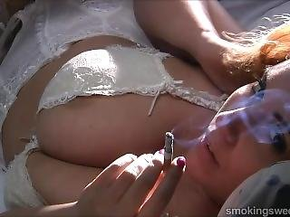 Big Breasted Luana Smoking
