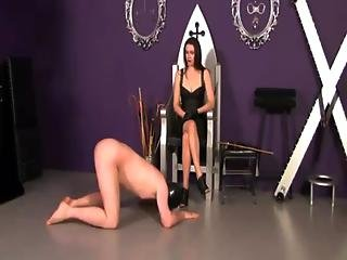 Domina Spanks And Paddles Her Hooded Sub