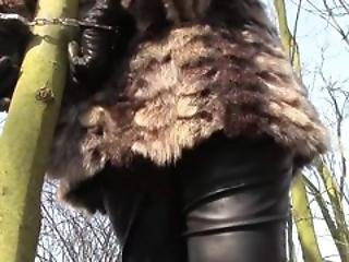 Outdoors Handcuffed In Fur Coat