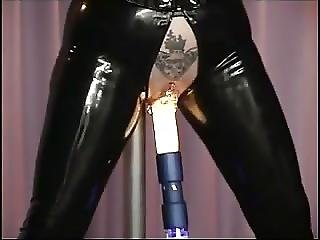 Pierced Mature In Latex Fucked By The Machine