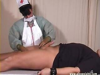 Gloved Nurse Milk Her Patient
