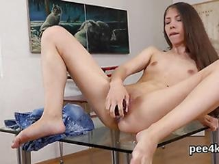 Enchanting Chick Is Peeing And Masturbating Shaven Cunt