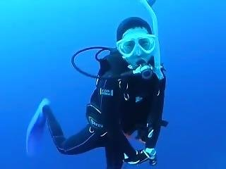 Cute Scuba Diving Woman Floating And Smiling Underwater