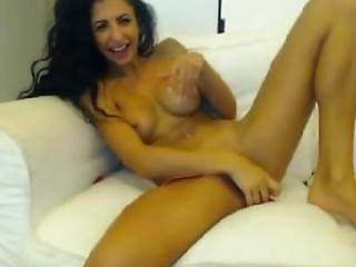 Long Haired Tattooed Brunette Has Strong Orgasms With Toys